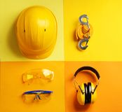 Flat lay composition with safety equipment. On color background royalty free stock image