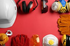Flat lay composition with safety equipment and space for text. On color background royalty free stock image