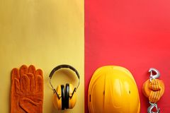 Flat lay composition with safety equipment and space for text. On color background stock images