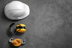 Flat lay composition with safety equipment and space for text. On grey background royalty free stock photos