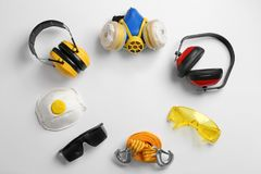 Flat lay composition with safety equipment and space for text on white. Background stock images