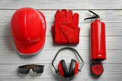 Flat lay composition with safety equipment. On wooden background royalty free stock images