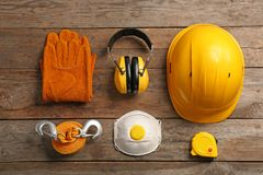Flat lay composition with safety equipment. On wooden background stock images