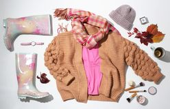 Flat lay composition with set of stylish winter outfit. On white background stock images