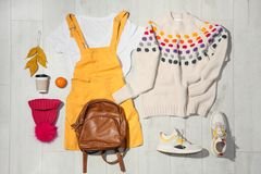 Flat lay composition with set of stylish winter outfit. On wooden background stock photography