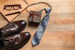 Flat lay composition with shoes, notebook, tie and gift box Stock Photography