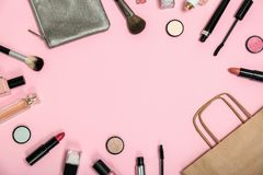 Flat lay composition with shopping bag and cosmetics. On color background stock photography