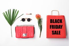 Flat lay composition with shopping bag. And text BLACK FRIDAY SALE on light background royalty free stock images
