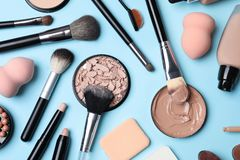 Flat lay composition with skin foundation, powder and beauty accessories. On color background stock photos