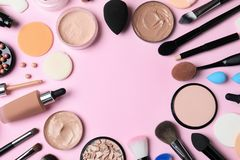 Flat lay composition with skin foundation, powder and beauty accessories on color background royalty free stock photo