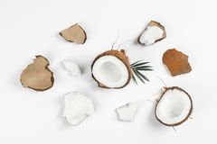 Flat lay composition with split coconut and its pieces royalty free stock photography