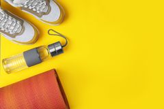 Flat lay composition of sport equipment on color background. Space for text stock photos