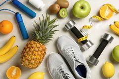 Flat lay composition with sport items and healthy food on grey background. Weight loss concept stock photos