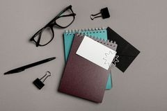 Flat lay composition with stationery on grey background. Mock up for design royalty free stock photos