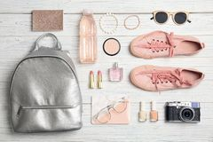 Flat lay composition with stylish accessories. And camera on light background Stock Images