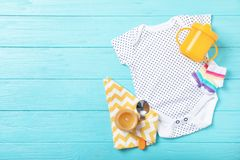 Flat lay composition with stylish baby clothes on wooden background. Space for text royalty free stock images