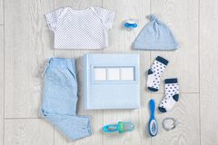 Flat lay composition with stylish child clothes. And accessories on wooden background royalty free stock photo