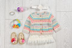 Flat lay composition with stylish child clothes. And accessories on wooden background royalty free stock image