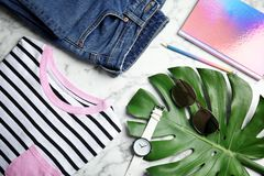Flat lay composition with stylish clothes and accessories. On marble table. Fashion blogger stock photo