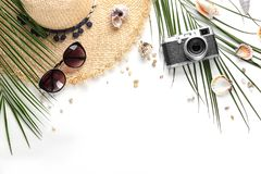 Flat lay composition with stylish hat, camera. And beach objects on white background royalty free stock image