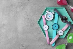 Flat lay composition with stylish wrist watches on grey background. Space for text stock photos