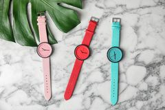 Flat lay composition with stylish wrist watches. On marble background. Fashion accessory stock image