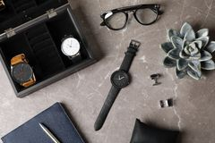 Flat lay composition with stylish wrist watches on table. Fashion accessory stock photography