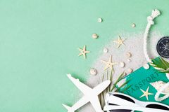 Flat lay composition with summer holidays, vacation and travel accessories on green table top view.  stock photo