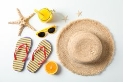 Flat lay composition with summer vacation accessories on white background, top view