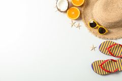 Flat lay composition with summer vacation accessories on white background,top view and space for text