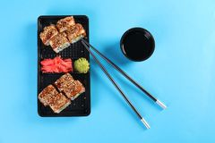 Flat lay composition with sushi rolls on color background. Food delivery stock photos