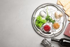 Flat lay composition with symbolic Passover Pesach items on color background. Space for text royalty free stock image