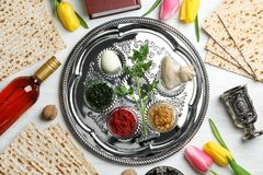 Flat lay composition with symbolic Passover Pesach items and meal. On color background stock photography