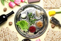Flat lay composition with symbolic Passover Pesach items and meal. On color background stock image