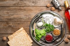 Flat lay composition with symbolic Passover Pesach items on wooden background. Space for text stock image