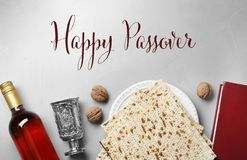 Flat lay composition of symbolic Pesach items on light background. Happy Passover royalty free stock photo