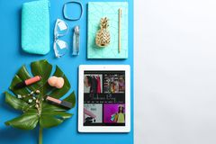Flat lay composition with tablet, makeup products and accessories on color background. Fashion blogger royalty free stock images