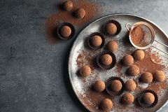 Flat lay composition with tasty chocolate truffles on grey background. Space for text royalty free stock photos