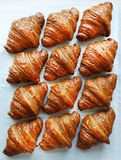 Flat lay composition with tasty croissants on patterned background. Stock Photo