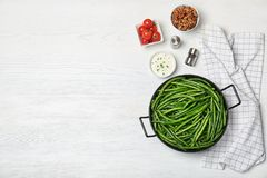 Flat lay composition with tasty green beans. On wooden table stock image