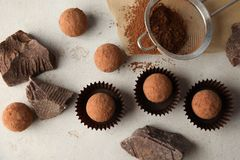 Flat lay composition with tasty raw chocolate truffles. On light background stock image