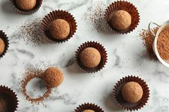 Flat lay composition with tasty raw chocolate truffles. On marble background royalty free stock image