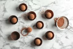 Flat lay composition with tasty raw chocolate truffles. On marble background royalty free stock photos