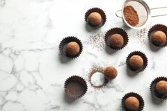 Flat lay composition with tasty raw chocolate truffles on marble background. Space for text stock photo