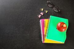 Flat lay composition for Teacher`s day. On chalkboard stock photography