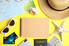 Flat lay composition with tourist items and notebook on color background. Travel agency. Flat lay composition with tourist items and notebook on color background royalty free stock photos