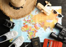 Flat lay composition with tourist items and world map. Travel agency. Flat lay composition with tourist items and world map on wooden background. Travel agency stock photos