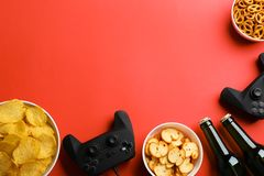 Flat lay composition with video game controllers, snacks and space for text stock images