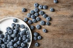 Flat Lay Composition With Juicy And Fresh Blueberries Royalty Free Stock Image