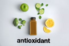 Flat lay composition with word ANTIOXIDANT. Healthy detox smoothie and ingredients on light background stock images